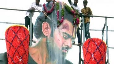 To celebrate 'Saaho' release, Prabhas fans pour milk on actor's cutout