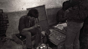 Nostalgia: Street shop for refilling lighter-gas and repairing watches
