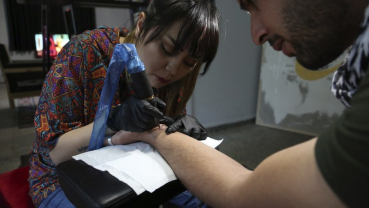 A tattoo at a time, Afghan woman takes on society's taboos