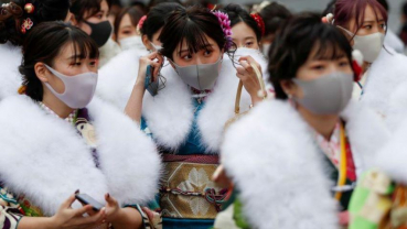 Young Japanese celebrate Coming of Age Day under COVID's shadow