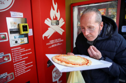 Fresh pizza vending machine prompts curiosity and horror in Rome