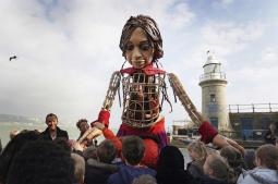 Puppet Little Amal arrives in UK after journey across Europe