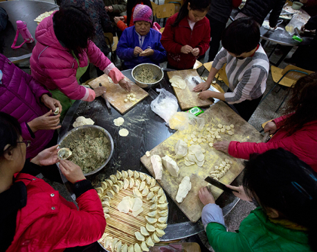 Chinese Lunar New Year feast begins with drums and dumplings