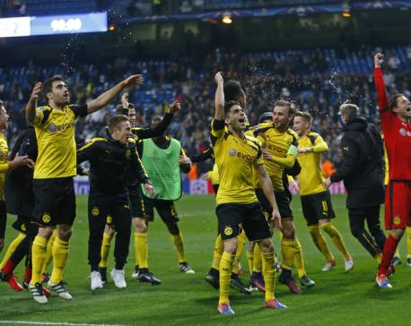 Dortmund holds Madrid 2-2 to win group, break scoring record