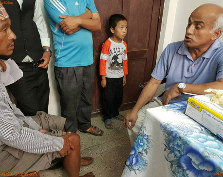 Dr KC providing free medical treatment in Rolpa