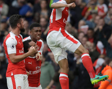 Cazorla comes to Arsenal's rescue with stoppage-time penalty