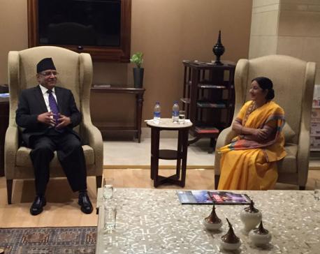 Swaraj receives PM Dahal at Indira Gandhi Int'l Airport