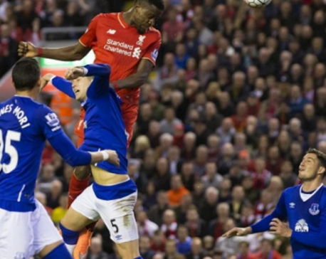 Liverpool routs Everton 4-0 but striker Origi is carried off