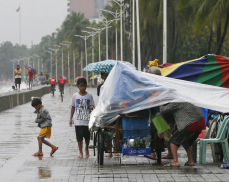 Floods kill 24 in Vietnam as Typhoon Sarika looms