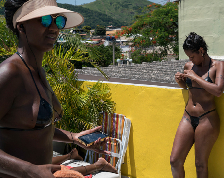 Electrical tape-bikinis and sun for perfect tan lines in Rio