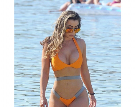 Busty Abigail Clarke flaunts her recent bum lift in sizzling orange bikini