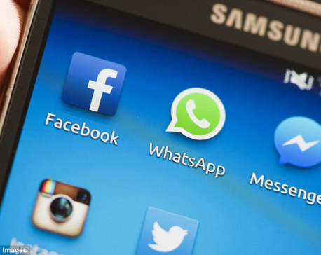 Facebook agrees to suspend using WhatsApp users' data