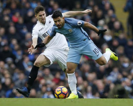 Jesus double lifts City to third with late Swansea win