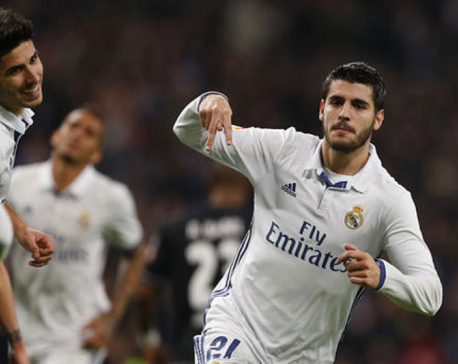 Isco scores twice as Madrid matches Barcelona's unbeaten record
