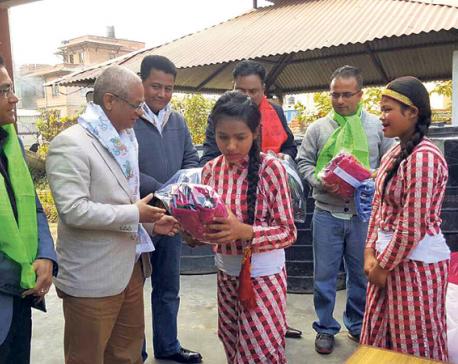 CE Construction distributes jackets to children