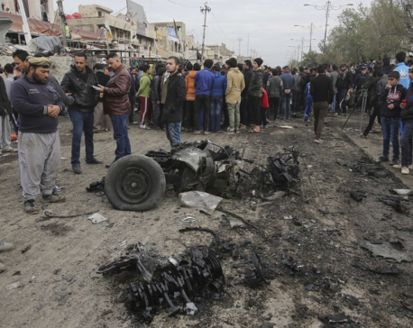 Car bomb strikes Baghdad market, killing at least 8