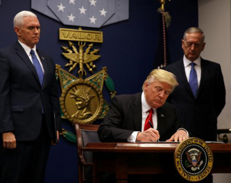 Trump bars door to refugees, visitors from seven nations