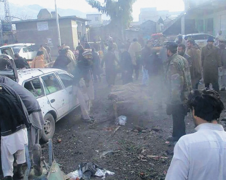 Bombing near Shiite place of worship kills 22 in NW Pakistan