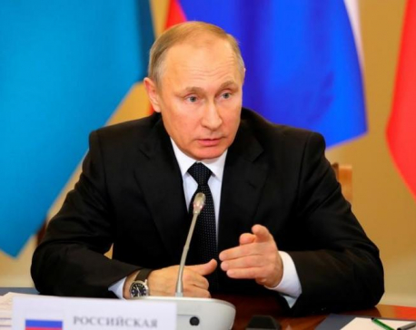 Russia's Putin says Syrian government, opposition sign ceasefire deal