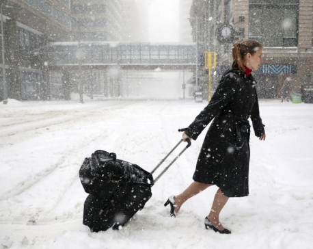 Flights canceled, roads treacherous amid spring snowstorms