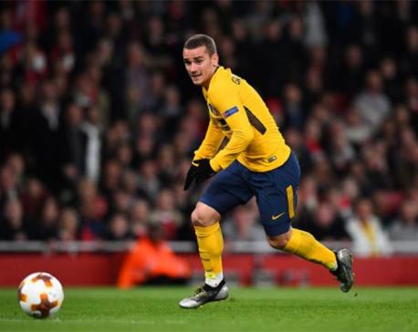 Griezmann strikes as 10-man Atletico punish wasteful Arsenal