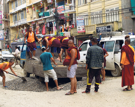 Monks take initiative to fill the potholes of Bauddha-Jorpati road