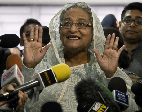 Election official says Bangladesh's ruling alliance won vote