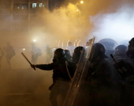 Hong Kong police fire tear gas as protests descend into chaos