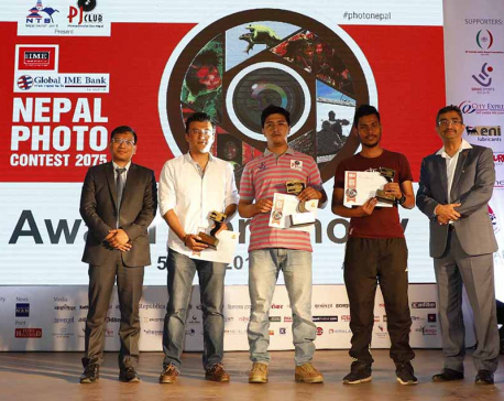 Photojournos Rokka and Rayamajhi bag photo contest award