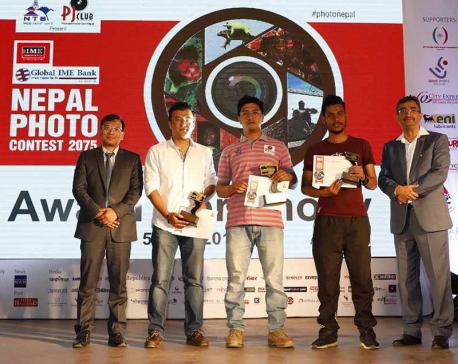 Photojournos Rokka and Rayamajhi bag photo contest award