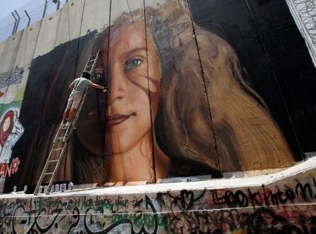 "New mural of Palestinian Ahed Tamimi painted on ""Occupation Wall"""