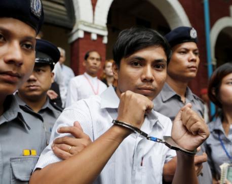 Myanmar judge convicts two Reuters reporters in landmark secrets case