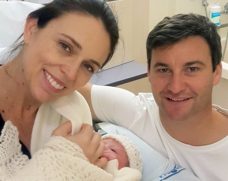 New Zealand leader welcomes newborn girl 'to our village'