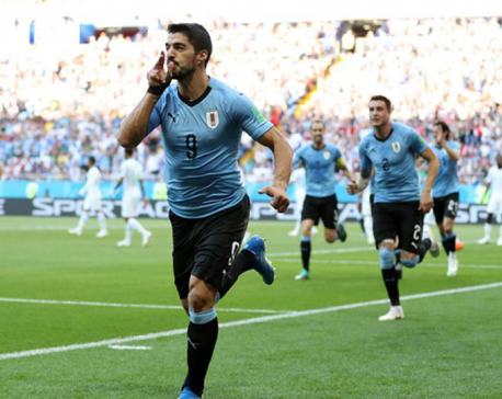 Uruguay beat Saudi Arabia to send themselves and Russia into last 16