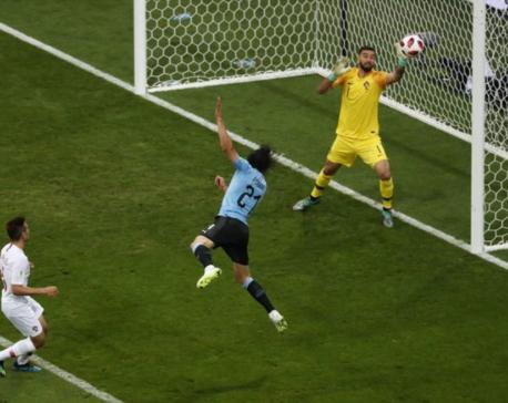 Brilliant Cavani brace fires Uruguay into last eight