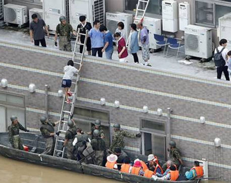 Death toll rises to nearly 100 as Japan scrambles to rescue flood victims