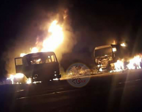 Two container trucks set on fire
