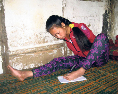 Handicapped girl writes her exams with foot