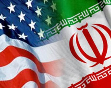 Iranian lawmakers set paper US flag ablaze at parliament