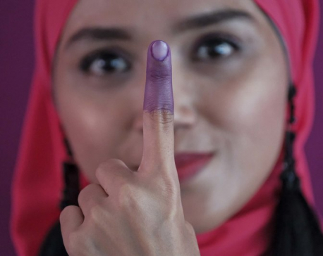 Malaysians vote in election defined by graft scandal, tax