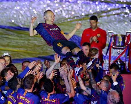 Champions Barca bid Iniesta farewell after beating Sociedad