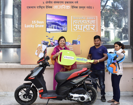 NRM lucky draw winner receives scooter