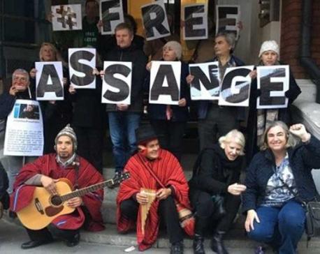 Assange's mother calls treatment of son 'Slow Assassination'