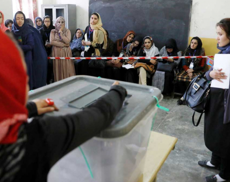 Afghans vote amid chaos, corruption and Taliban threats