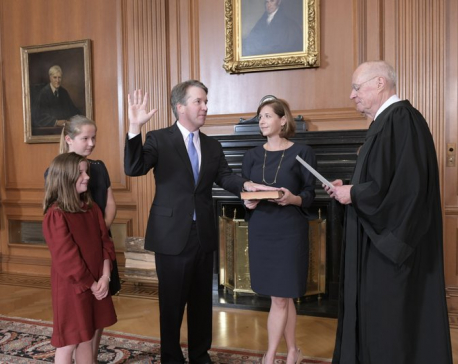 Kavanaugh sworn in as protesters chant outside Supreme Court