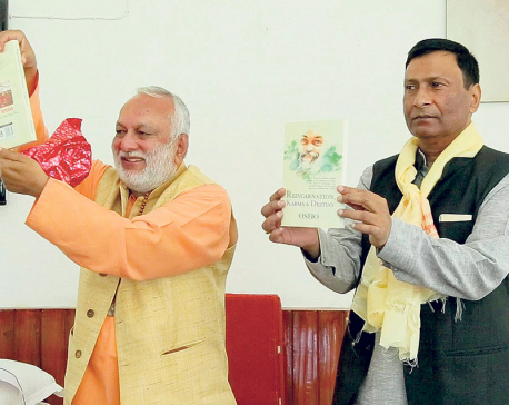 Om Prakash Mishra releases 'Reincarnation, Karma and Destiny'