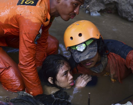 Burials begin in quake- and tsunami-hit Indonesian region