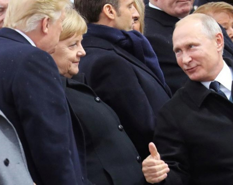 Thumbs up! Putin shakes hands with Trump and Melania during WWI ceremony in Paris