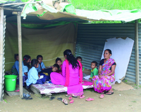 Kids studying in 'classroom' made of tin sheets