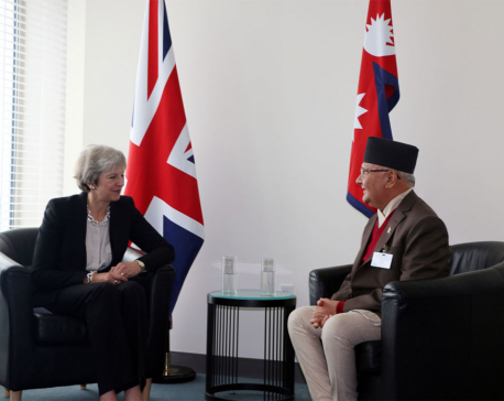 PM Oli, British PM May hold meeting